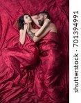 couple in love lies on burgundy ... | Shutterstock . vector #701394991