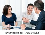 happy couple seal a deal with... | Shutterstock . vector #70139665