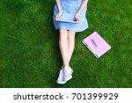 woman sitting on green grass... | Shutterstock . vector #701399929