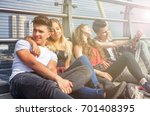 group of friends sitting... | Shutterstock . vector #701408395
