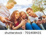 group of friends sitting... | Shutterstock . vector #701408431