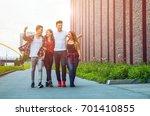 group of friends walking... | Shutterstock . vector #701410855