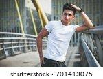 handsome young man on walk in... | Shutterstock . vector #701413075