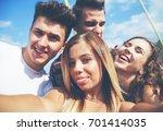 selfie of group of teenage... | Shutterstock . vector #701414035