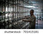 a worker working on warp...   Shutterstock . vector #701415181