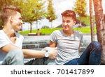 two friends casual wear sitting ... | Shutterstock . vector #701417899