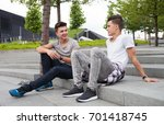 two friends casual wear sitting ... | Shutterstock . vector #701418745