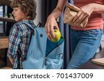 partial view of mother putting... | Shutterstock . vector #701437009