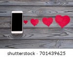 smartphone and hearts paper on...   Shutterstock . vector #701439625
