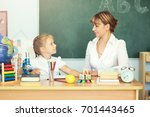 cute schoolgirl and her teacher ... | Shutterstock . vector #701443465