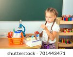 young girl making science... | Shutterstock . vector #701443471