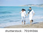 happy young couple in white... | Shutterstock . vector #70144366