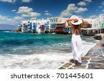 attractive female tourist with... | Shutterstock . vector #701445601