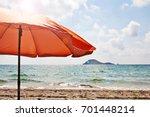 Orange Umbrella On The Beach ...