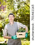 Small photo of Photo of agronomist with cucumbers