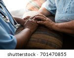 midsection of nurse and patient ... | Shutterstock . vector #701470855