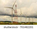 windmills for electric power... | Shutterstock . vector #701482201