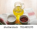 olive oil in a glass jug. in...