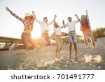 group of friends on beach... | Shutterstock . vector #701491777