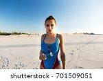 girl in blue swim suit stands... | Shutterstock . vector #701509051