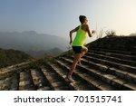 fitness woman trail runner... | Shutterstock . vector #701515741