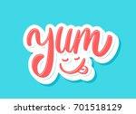 yum. yummy. vector lettering. | Shutterstock .eps vector #701518129