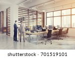 people in an open space office... | Shutterstock . vector #701519101