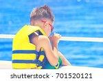 small boy wearing life jacket... | Shutterstock . vector #701520121