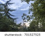 park alley with trees against... | Shutterstock . vector #701527525