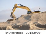 Excavator Scooping Sand On A...