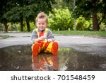 child in rainy day. cute happy... | Shutterstock . vector #701548459