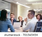 group of a young business... | Shutterstock . vector #701565454