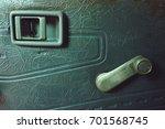 Small photo of Car door inside with door handle and manual door window regulator.