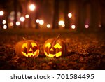 two kind halloween pumpkins in... | Shutterstock . vector #701584495