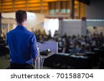 man presenting to audience | Shutterstock . vector #701588704