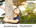 happy asian cute little girl is ... | Shutterstock . vector #701590297