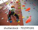 determined boy practicing rock... | Shutterstock . vector #701595181