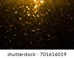 abstract gold bokeh with black... | Shutterstock . vector #701616019