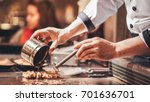 hand of man take cooking of... | Shutterstock . vector #701636701