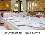 table setting with white plates ... | Shutterstock . vector #701656945