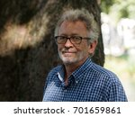 active pensioner in a park... | Shutterstock . vector #701659861