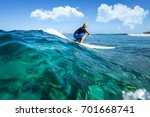 muscular surfer with long white ... | Shutterstock . vector #701668741