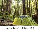 tent under a dense redwood... | Shutterstock . vector #701674054
