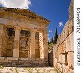 Small photo of /Athenian Treasury/Athenian Treasury at Delphi, Greece. Doric architecture. Made of Parian marble.