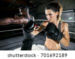 athletic female fighter throws... | Shutterstock . vector #701692189