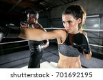 fighter and trainer in intense... | Shutterstock . vector #701692195