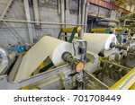 Small photo of Paper production plant. Plant on production of paper towels. fragment of the industrial machine