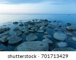 calm evening on the rocky shore ... | Shutterstock . vector #701713429
