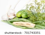 Small photo of Ingredients for making brined pickles (cucumbers, garlic, dill and horseradish)