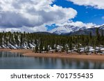 Small photo of Pike's Peak Covered in Fresh Snow Looms Over South Catamount Reservoir